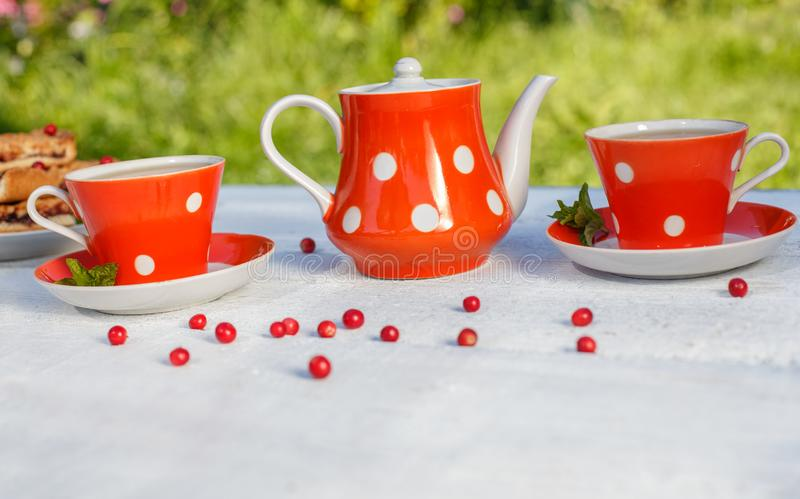 Time to drink tea outdoors in the garden. Summertime scene.  royalty free stock image