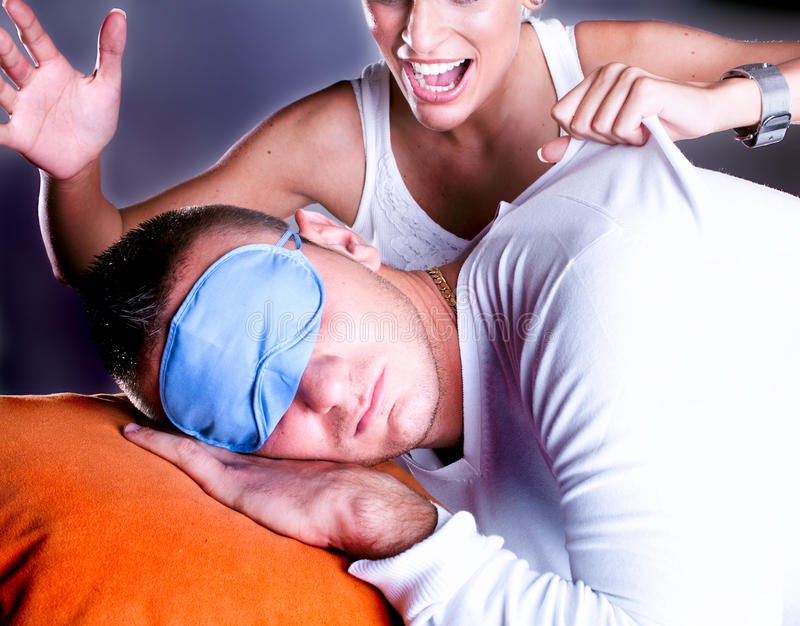 Time to get up, woman wake up a man. Time to get up. Angry woman wake up a man royalty free stock photography