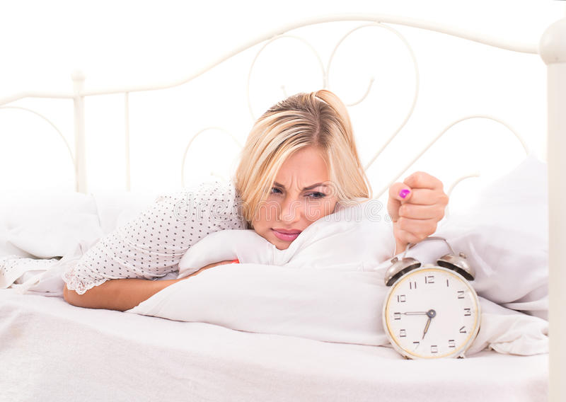 It is time to get up. For young blonde woman royalty free stock photos