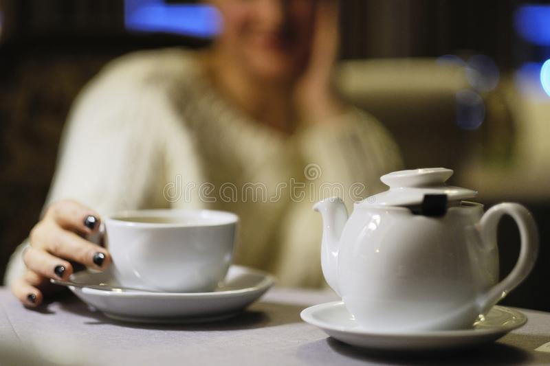 Time to have tea.Teapot with a cup of tea stock image