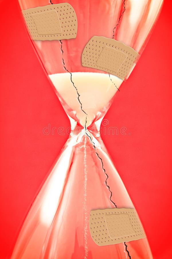 Time to heal - concept image with cracked hourglass and bandaid on red background.  stock photography