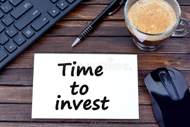 Time to invest words on paper royalty free stock photos
