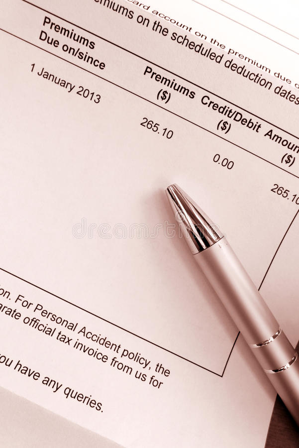 Paying Insurance Premium Bill Stock Photo - Image of costs ...