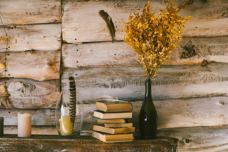 time to read books. books and candles on the table. wooden background. vintage. royalty free stock photo