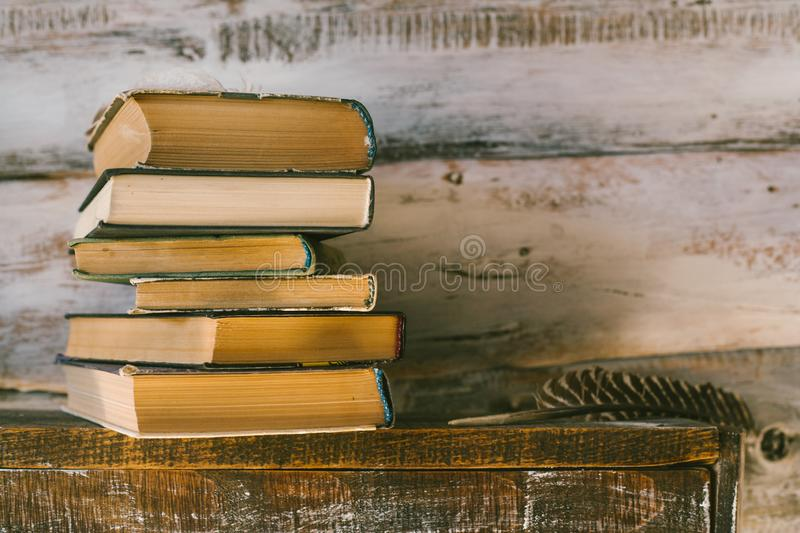 time to read books. books on the table. wooden background. vintage. stock image