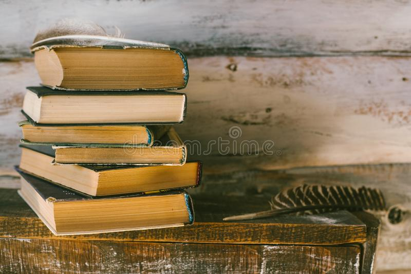 time to read books. books on the table. wooden background. vintage royalty free stock photo