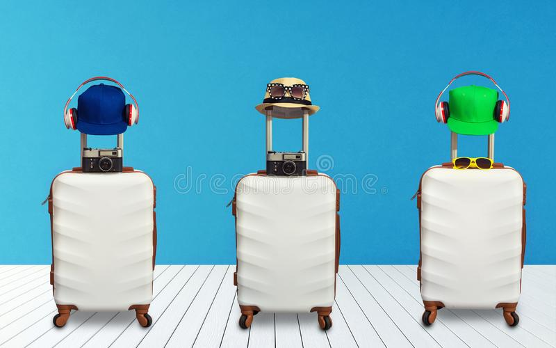 Time to Relax, traveling suitcase with hat standing on the floor out the room.Travel concept.Collage. stock image