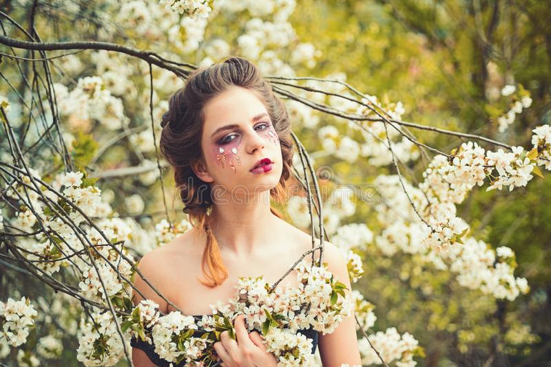 Time to relax. Woman with spring fashion makeup. face skincare. womens health. allergy to flowers. Natural beauty and royalty free stock photo