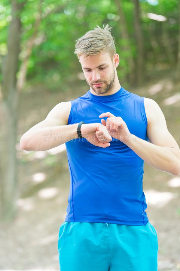 Time to start. Handsome sportsman in sportswear outdoors. Active sportsman training outdoor. Sportsman living healthy royalty free stock image