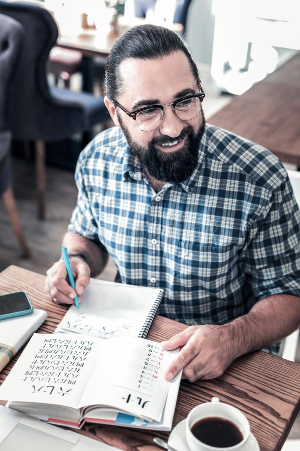 Cheerful businessman feeling excited studying foreign language royalty free stock images