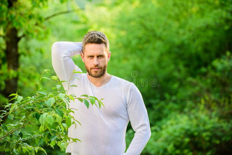 Time to think. ecological life for man. man in green forest. morning in nature. healthy lifestyle. nature health. mature stock image