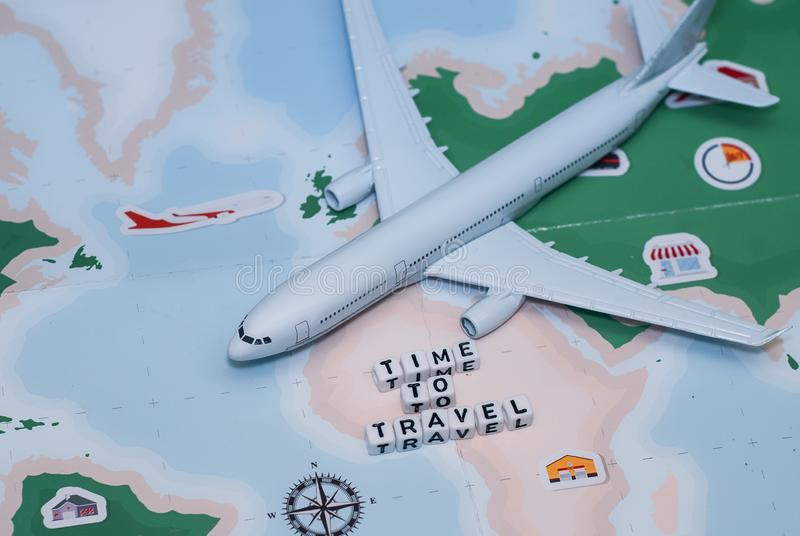 Time to Travel. Idea for tourism with airplane, compass and map on a light background. Concept on the theme of flights. royalty free stock photos