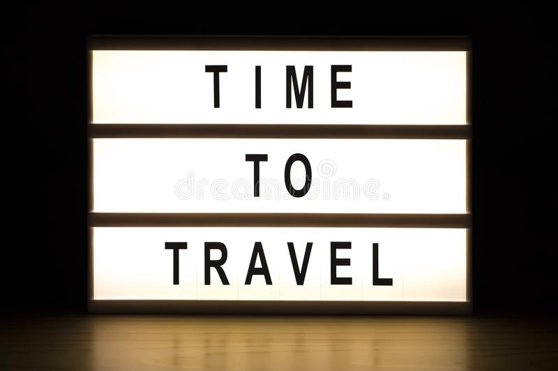 Time to travel light box sign board. On wooden table royalty free stock photography