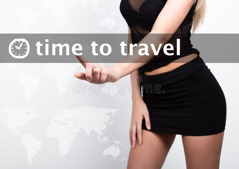 Time to travel written on a virtual screen. Internet technologies in business and tourism. woman in little black dres. Presses a finger on a virtual screen royalty free stock images
