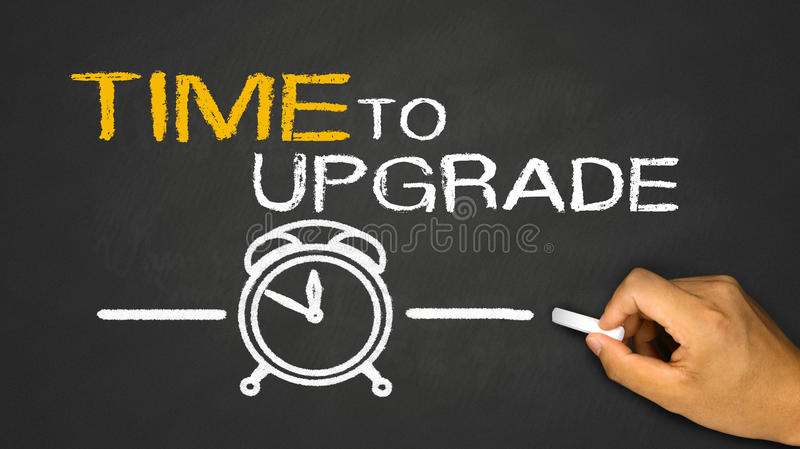 Time to upgrade. Concept on blackboard background royalty free stock photos
