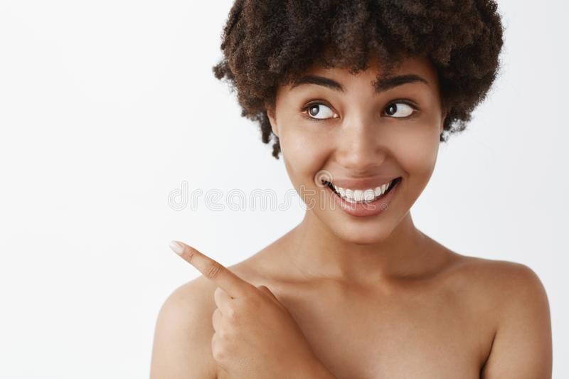 Time to use this product to clean skin and make body healthy. Good-looking shy and tender feminine african american stock images