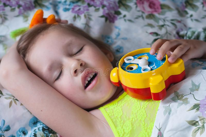 Time to wake up in school . Children's alarm clock stock photo