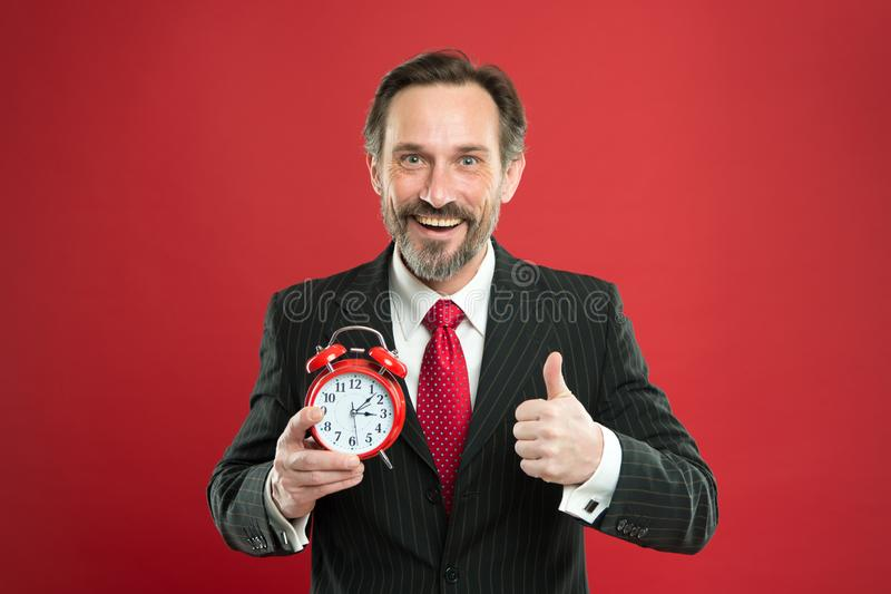 Time to work. Businessman care about time. Time management skills. How much time left till deadline. Manager with alarm royalty free stock images