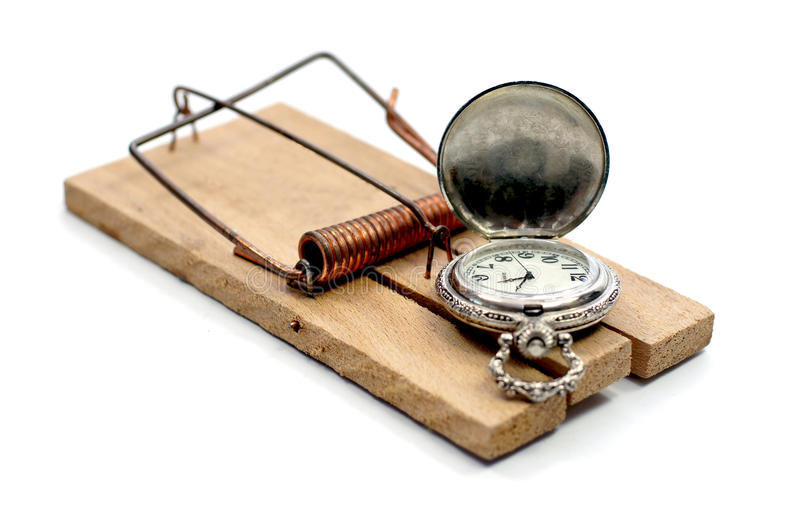 Time trap. A pocket watch is on a mousetrap stock photo