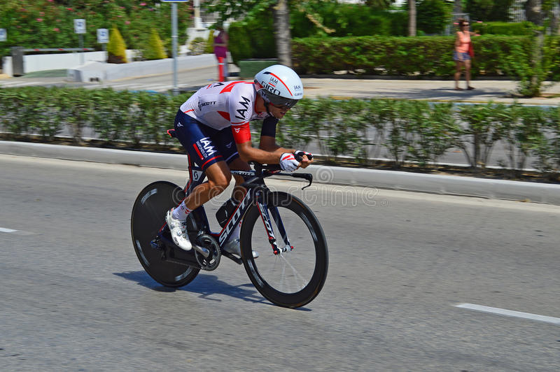 Time Trial Rider From Team IAM. The rider speeds past in the tuck position during the time trial stage of the 2016 La Vuelta España stock image