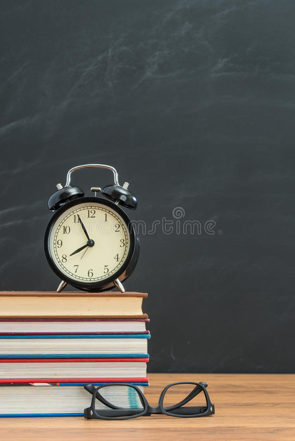 on time is very important remember to set up alarm clock and bring glasses stock photos