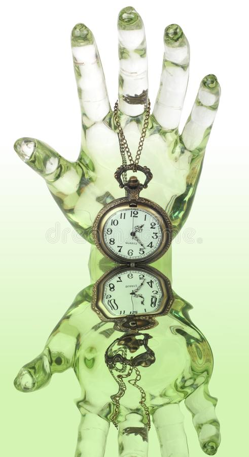 Time Warp. A glass hand and pocket watch and it's watery reflection royalty free stock photo