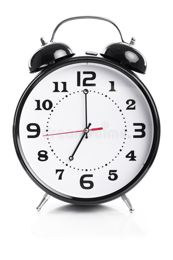 Time for work - Alarm Clock Shows Seven o`clock royalty free stock photo