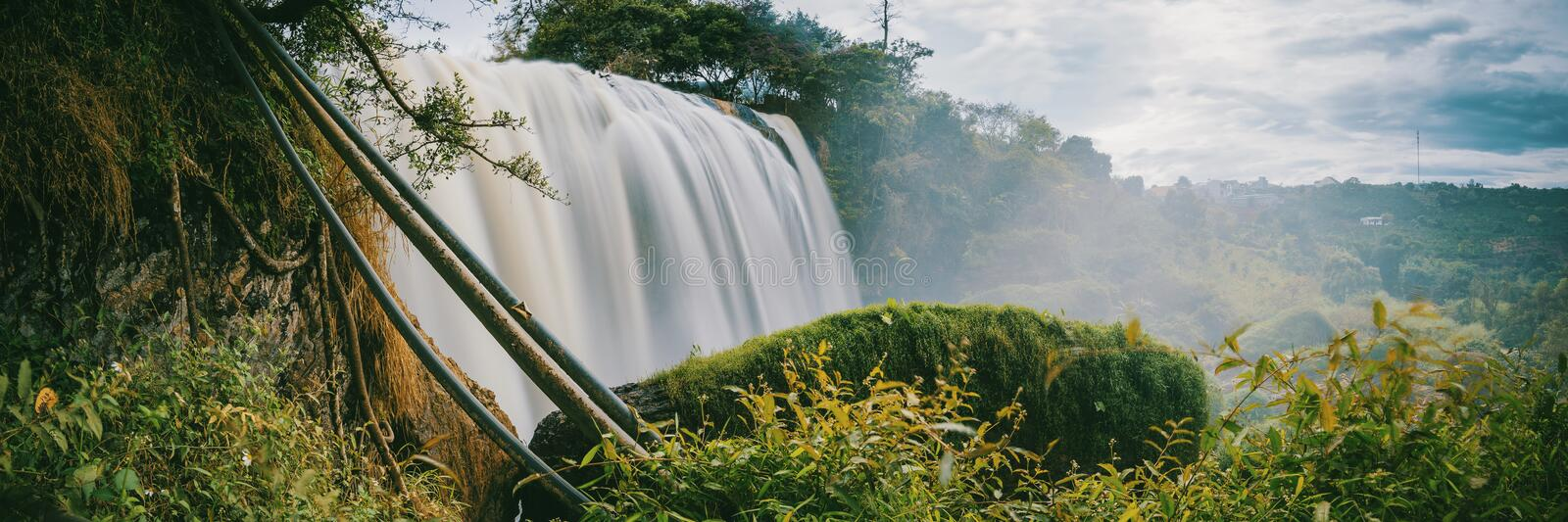 Timelapse Photo of Water Falls Between Trees stock photography