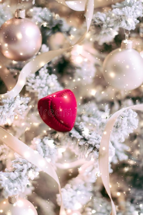 Heart shaped jewellery gift box on Christmas tree, love present for New Years Eve, Valentines Day and winter holidays. Timeless luxury, romantic proposal and royalty free stock photography