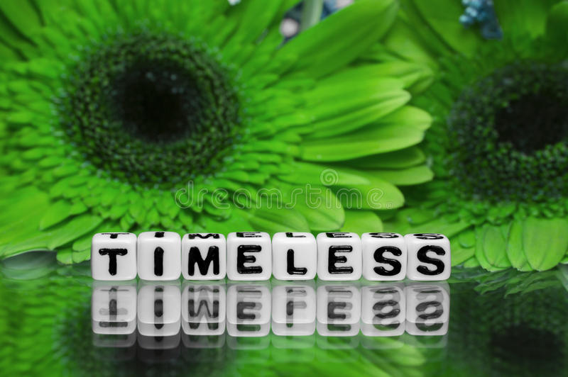 Timeless text message with green flowers. In the background stock photos