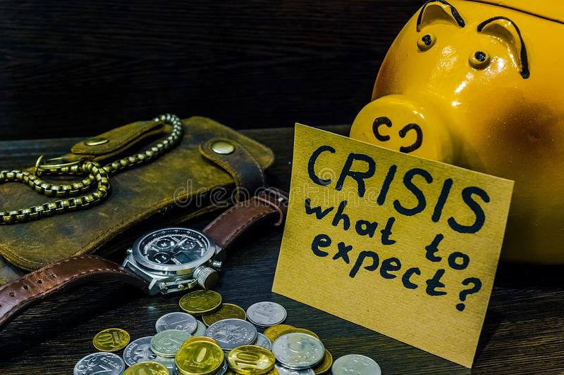 In times of crisis it`s time to think about the piggy Bank stock photography