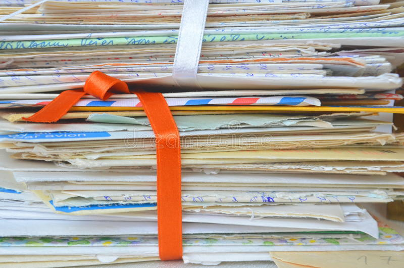 Times gone by - slow mail communication, memories, closeup of old handwritten letters for backgrounds royalty free stock photography