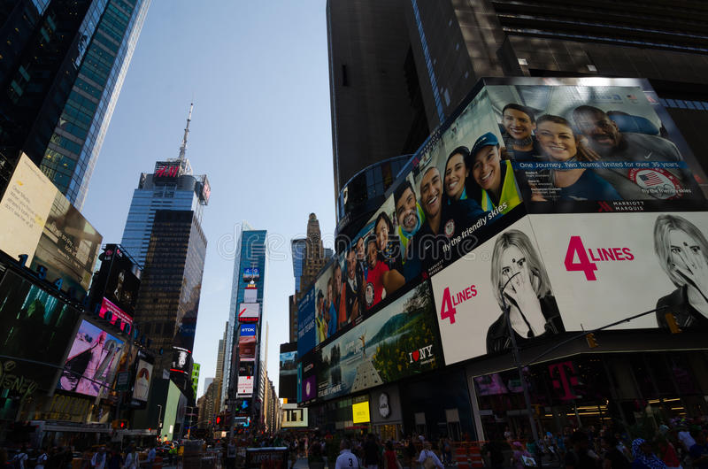 Times Square, Broadway theaters and led signs, a symbol of New Y. New York City, USA - Aug 09, 2016: Times Square is a busy touristic intersection of neon lights royalty free stock image