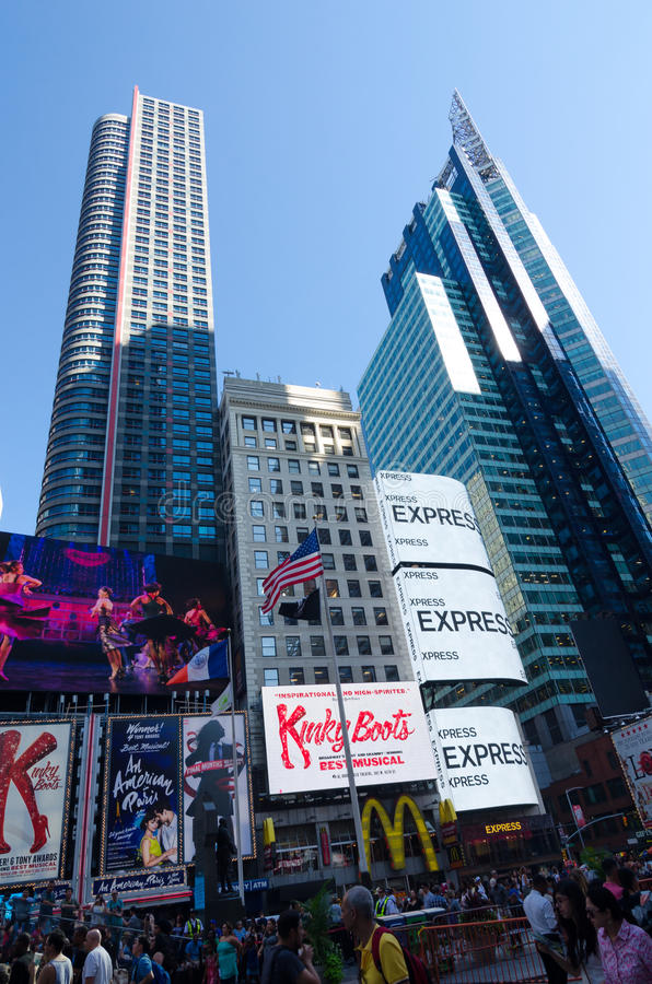 Times Square, Broadway theaters and led signs, a symbol of New York. New York City, USA - Aug 09, 2016: Times Square is a busy touristic intersection of neon royalty free stock photos