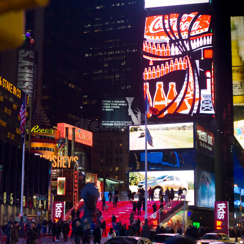Times Square and Broadway Theaters at night. NEW YORK CITY - FEBRUARY 4: Times Square and Broadway Theaters with crowd of tourists and residents at night, one royalty free stock photos