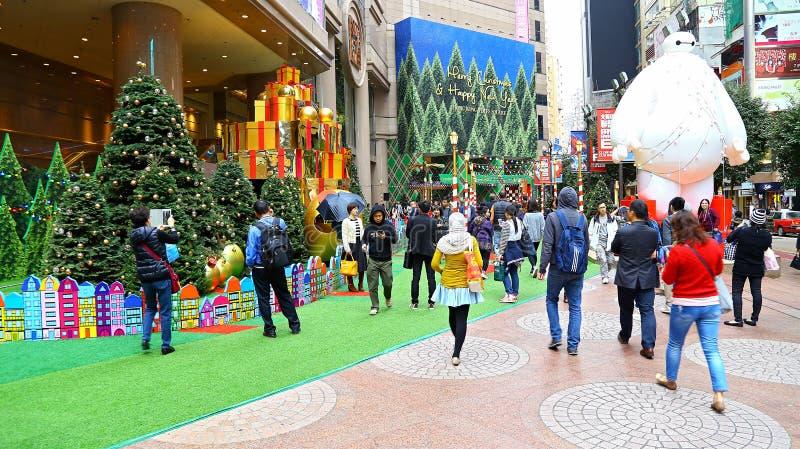 Times Square christmas decor, hong kong. Visitors around the beautiful christmas decorations at times square shopping mall at causeway bay, hong kong royalty free stock image