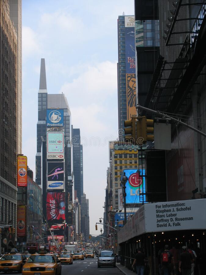 Times Square day. NEW YORK, USA - August 2005: travel view of Times Square featuring day. The image location is New York in America royalty free stock photos
