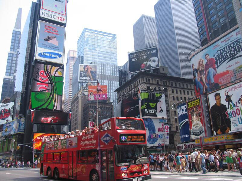Times Square day red bus. NEW YORK, USA - August 2005: travel view of Times Square featuring day red bus. The image location is New York in America royalty free stock images