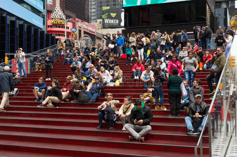 Times square new york. NEW YORK - APRIL 28, 2016: Unknown people on the famous red stairs on Times Square stock images