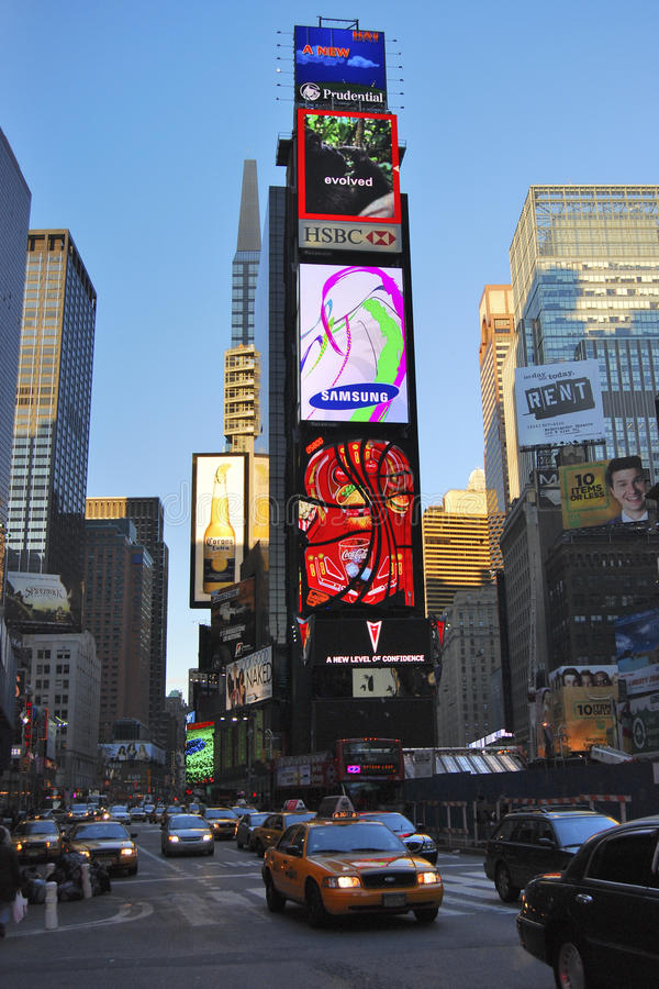 Times square, New York city. These enormous tv screens are the worlds interpretation of Times square, New York. It certainly is a very busy area, this image stock image