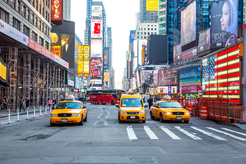 Times Square New York. New York City - April 5: Times Square, featured with Broadway Theaters and animated LED signs, is a symbol of New York City and the United stock photos