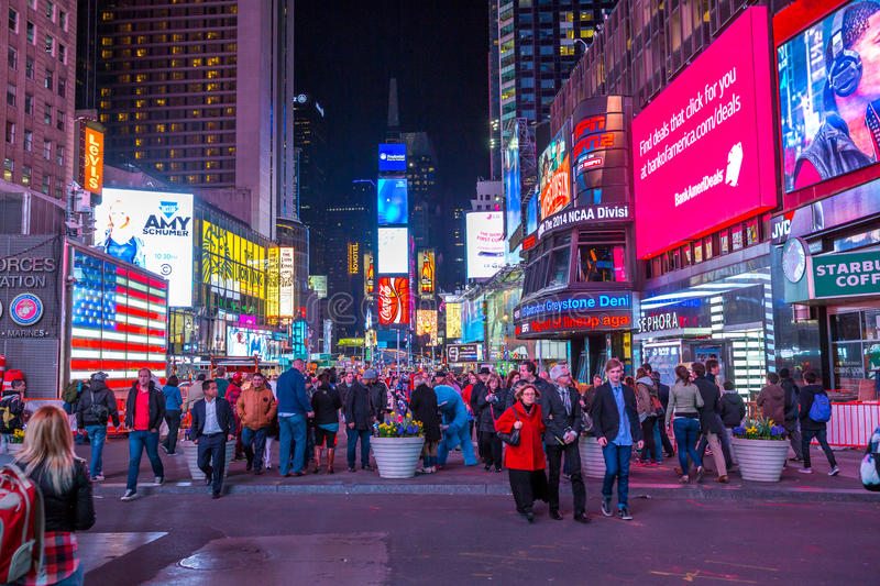 Times Square. New York City -April 8: Times Square, featured with Broadway Theaters and animated LED signs, is a symbol of New York City and the United States stock photo