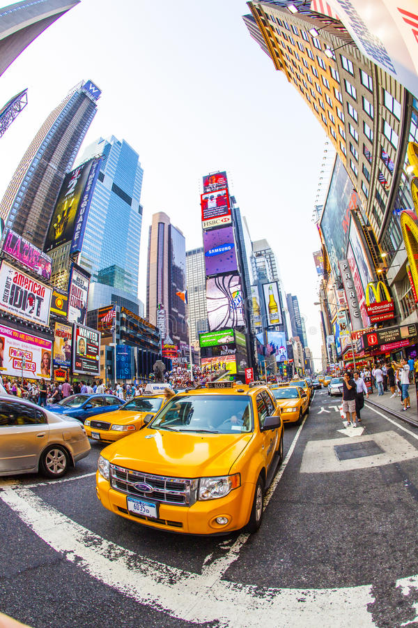 Times square in New York. NEW YORK CITY - JUL 8: Times Square, featured with Broadway Theaters and huge number of LED signs, is a symbol of New York City and the royalty free stock photos