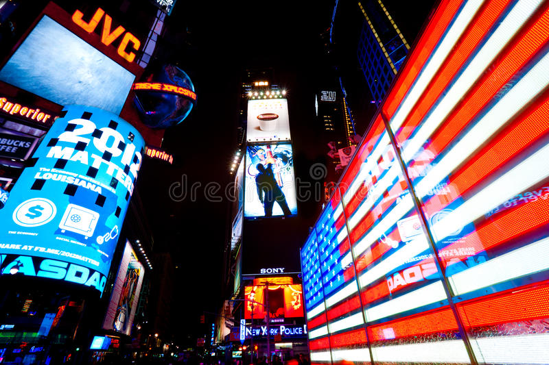 Times Square, New York City, USA. NEW YORK CITY -MARCH 25: Times Square, featured with Broadway Theaters and animated LED signs, is a symbol of New York City royalty free stock photo
