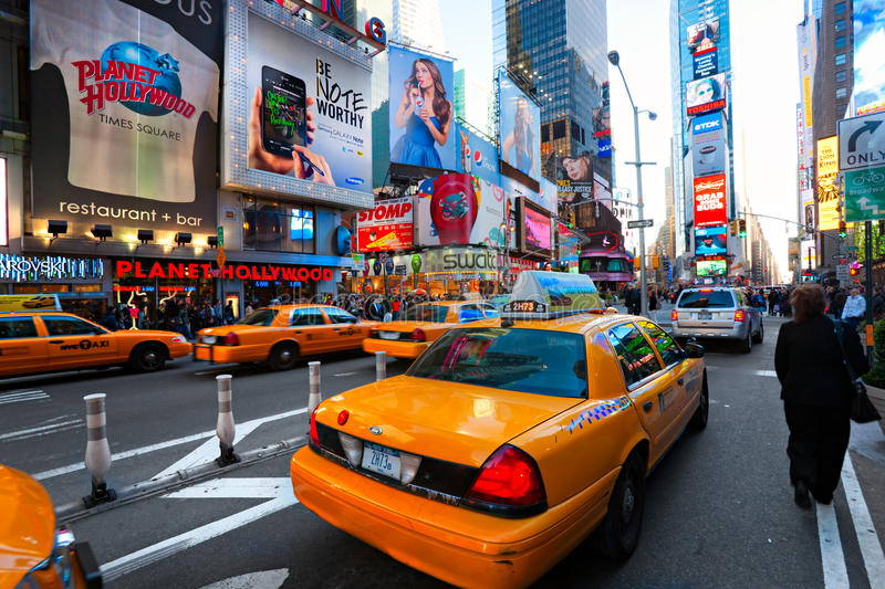 Times Square, New York City, USA. NEW YORK CITY -MARCH 25: Times Square, featured with Broadway Theaters and animated LED signs, is a symbol of New York City stock image
