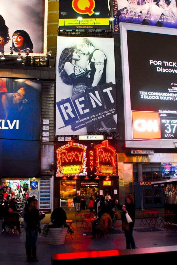 Times Square, NYC, panneau-réclame de loyer photographie stock libre de droits