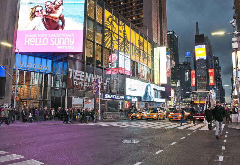 Times Square pedonal crossing. NEW YORK CITY - DECEMBER 7, 2016: night view of LED signs and people in Times Square on December 7 2016. Times Square is one of stock photography