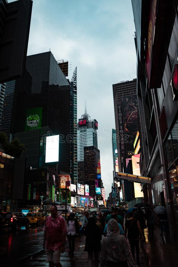 Times Square on rainy day, foggy outside royalty free stock image