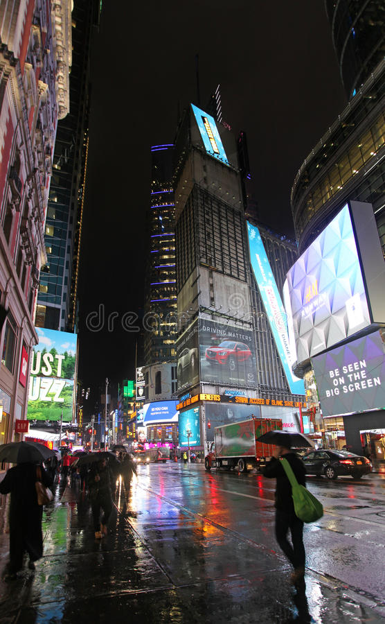 Times Square by rainy night, NYC stock images