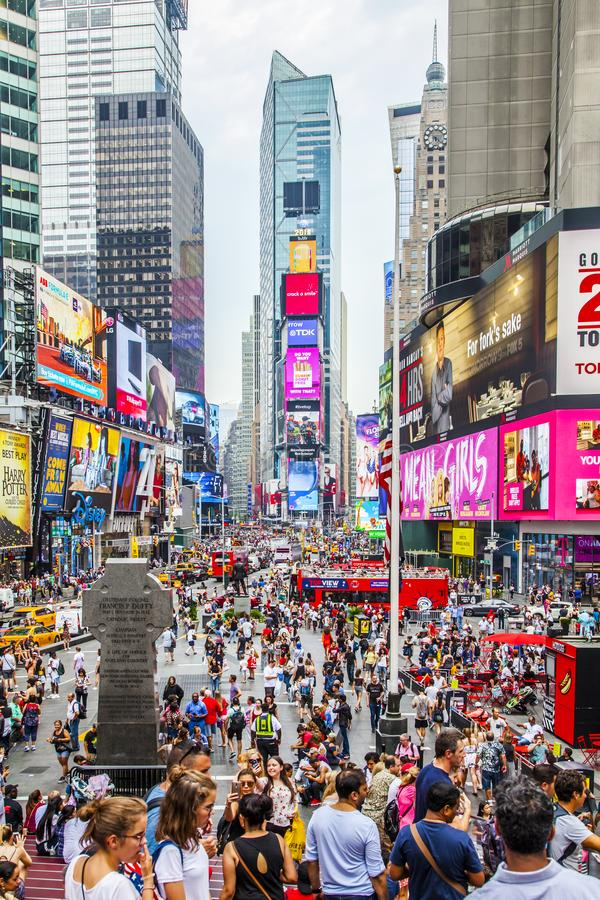 Times Square with tourists and LED billboards stock photography